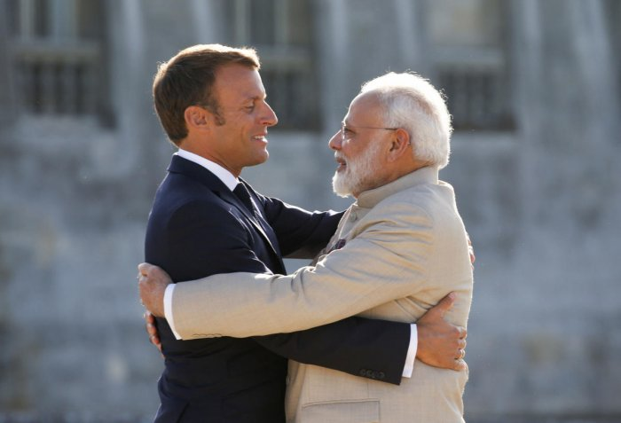 Chantilly: French President Emmanuel Macro, left, welcomes Indian Prime Minister Narendra Modi before a meeting at the Chateau of Chantilly. (PTI Photo)
