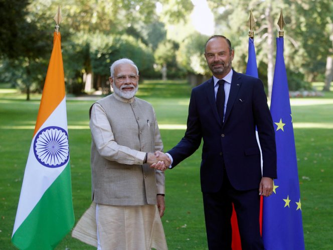 Prime Minister Narendra Modi shakes hands with French Prime Minister Edouard Philippe in the garden of the Prime Minister's residence before their talks in Paris, France. Reuters photo
