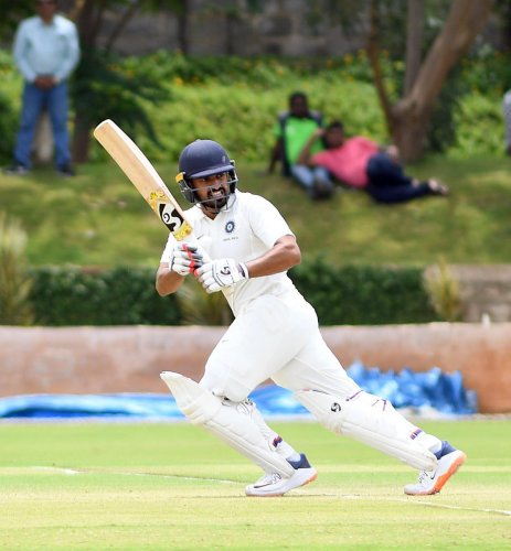 India Red's Karun Nair directs one en route to his unbeaten 92 against India Blue on the first day of second Duleep Trophy game in Alur on Friday. DH PHOTO/  Srikanta Sharma R