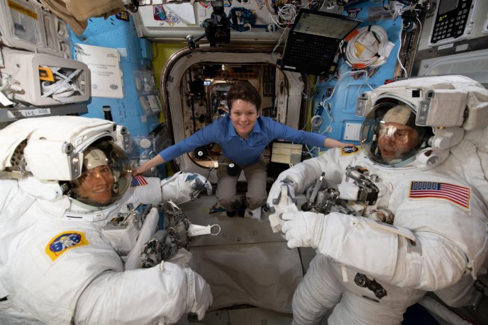 A file photo of astronaut Anne McClain (centre) on the International Space Station as she assists fellow astronauts Christina Koch and Nick Hague before a spacewalk. Credit: Reuters