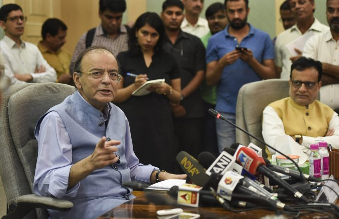 Union Finance Minister Arun Jaitley addresses the media at North Block, in New Delhi, Thursday. Jaitley announced a cut of Rs 1.50 on excise duty for crude oil and an additional Re 1 will be absorbed by OMCs with immediate effect. PTI