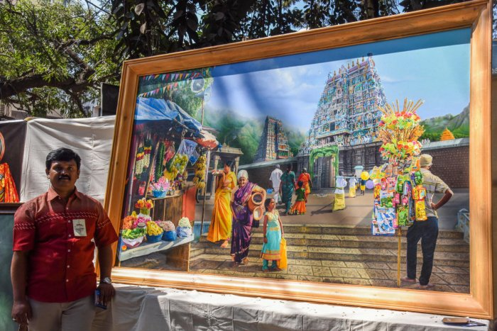 Gokulam Vijay, artist from Coimbatore, exhibits his painting that costs Rs 12 lakh at the fair. DH PHOto/S K Dinesh