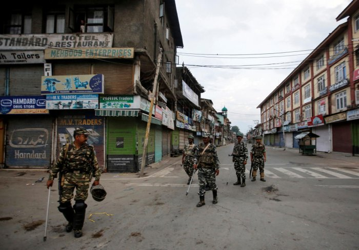 Security forces personnel patrol a deserted street during restrictions after the government scrapped special status for Kashmir, in Srinagar. (Reuters Photo)