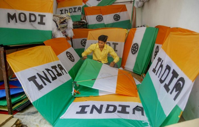 A kitemaker makes 'tricoloured' kites ahead of Independence Day, at a shop in Jammu (PTI Photo)