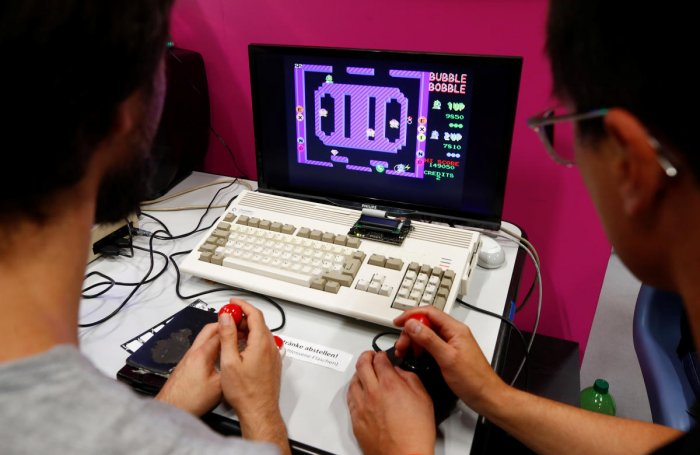 Two gamers play Bubble Bobble on a historic Amiga 1200 computer in the hall for retro games of Europe's leading digital games fair Gamescom, which showcases the latest trends of the computer gaming scene in Cologne, Germany. Reuters