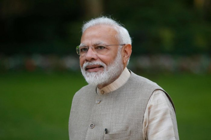Modi reached UAE capital Abu Dhabi from Paris on Friday on the second leg of his three-nation tour to France, UAE and Bahrain. (AFP Photo)