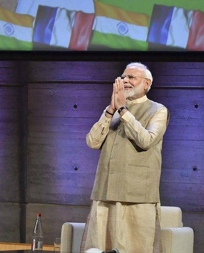 Prime Minister Narendra Modi greets Indian community in France at UNESCO HQ in Paris,France. (PTI Photo)