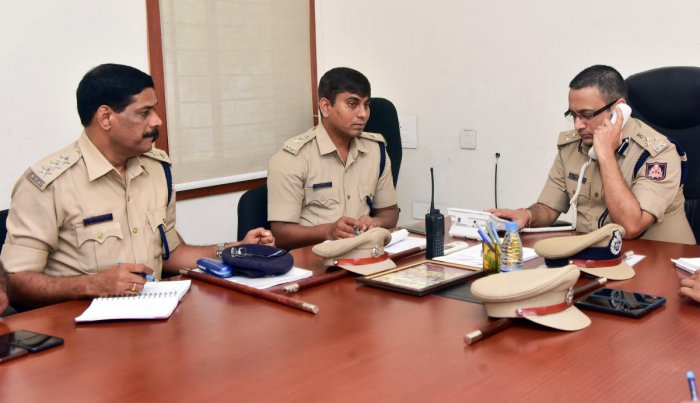 Commissioner of Police Dr P S Harsha receives a call during the weekly phone-in programme in Mangaluru on Friday.