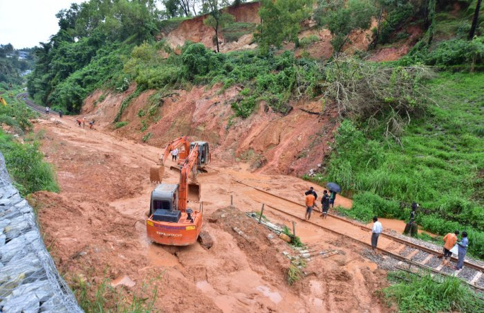 The work on clearing the debris blocking railway track at Kulashekar, on the outskirts of Mangaluru, is in progress. DH photo / Govindraj Javali