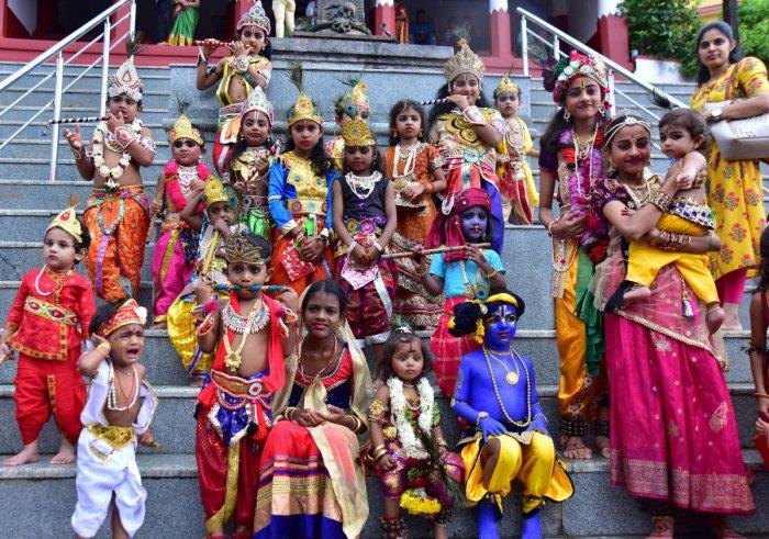 Children dressed as Krishna and Radha pose for a photograph at Sri Manjunatha Temple in Kadri in Mangaluru on Friday.