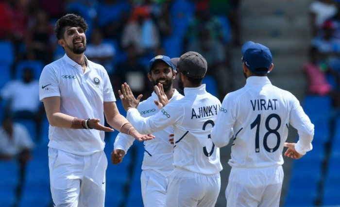 India's bowlers shared the spoils in putting the West Indies on the back foot at 82 for three in reply to their opponents first innings total of 297 at tea on the second day of the first Test. (AFP Photo)