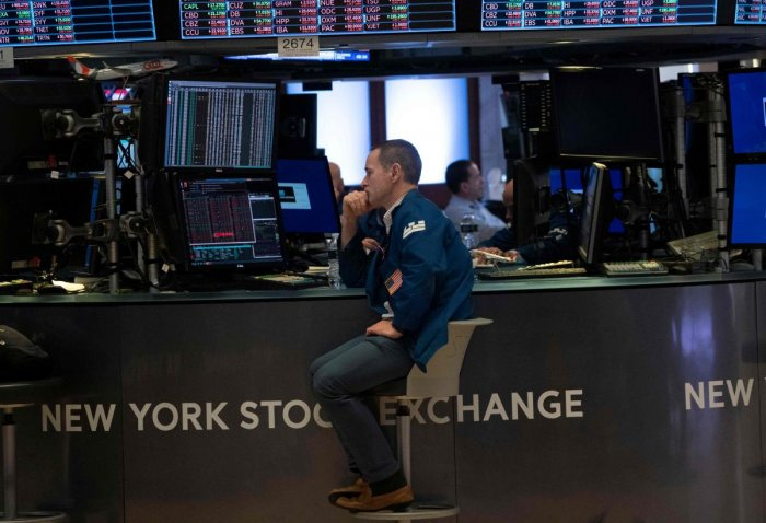 Traders work the floor of the New York Stock Exchange on August 23, 2019 in New York. (AFP Photo)