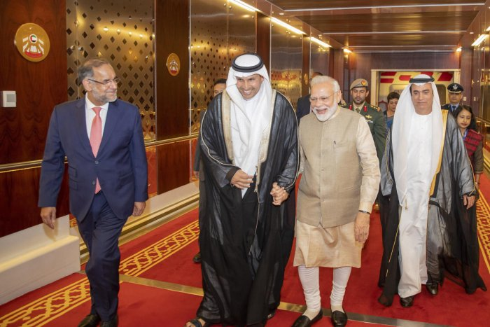 Indian Prime Minister Narendra Modi, second from right, walks with Khaldoon Khalifa al-Mubarak, second from left, chairman of the Abu Dhabi Executive Affairs Authority, after arriving in Abu Dhabi, United Arab Emirates. AP/PTI photo