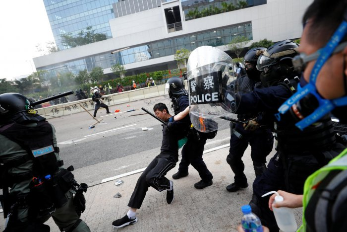 Riot police detain a demonstrator as they clash during a protest in Hong Kong, China. Reuters photo