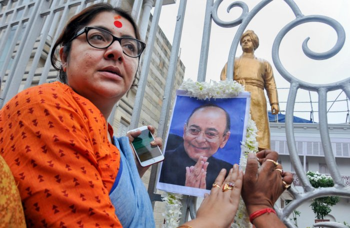 Actress turned BJP Lok Sabha MP Locket Chatterjee pays tribute to former finance minister Arun Jaitley at the ancestral house of Swami Vivekananda, in Kolkata, Saturday. PTI photo