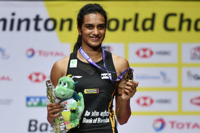 First-placed India's Pusarla Venkata Sindhu poses on with the gold medal during the podium cermony after her victory over Japan's Nozomi Okuhara during their women's singles final match at the BWF Badminton World Championships at the St Jakobshalle in Basel. AFP photo