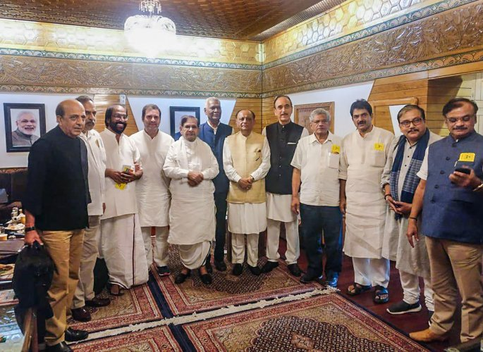 Congress leader Rahul Gandhi and Ghulam Nabi Azad, Left party leaders D Raja and Sitaram Yechury, Loktantrik Janata Dal (LJD) chief Sharad Yadav, DMK MP Tiruchi Siva and others at Srinagar airport, Saturday, Aug 24, 2019. (PTI photo)