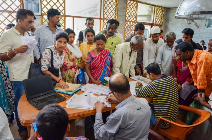 People check their names in the National Register of Citizens (NRC) list during a hearing at a Seva Kendra, in Guwahati, Tuesday, May 07, 2019. (PTI Photo)