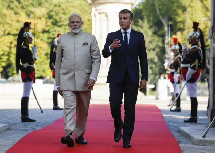 Chantilly: French President Emmanuel Macron, right, welcomes Indian Prime Minister Narendra Modi before a meeting at the Chateau of Chantilly, north of Paris, Thursday, Aug. 22, 2019. Indian Prime Minister Narendra Modi will be a guest at the G7 in Biarri