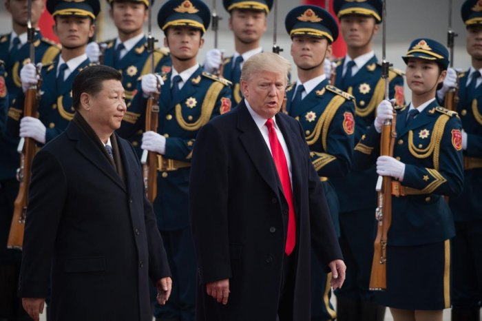 The United States will not win the trade war because of the plight faced by its farmers and businesses, said the ruling Communist Party's People's Daily. AFP