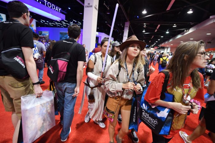 """Attendees visit the main hall at the D23 Expo, billed as the """"largest Disney fan event in the world,"""" on August 23, 2019 at the Anaheim Convention Center in Anaheim, California. (Photo by AFP)"""