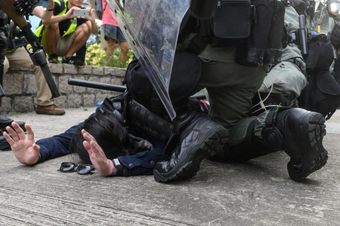 Police arrest a protester at Kowloon Bay in Hong Kong's Kwun Tong district on August 24, 2019, during clashes in the latest opposition to a planned extradition law that has since morphed into a wider call for democratic rights in the semi-autonomous city. AFP