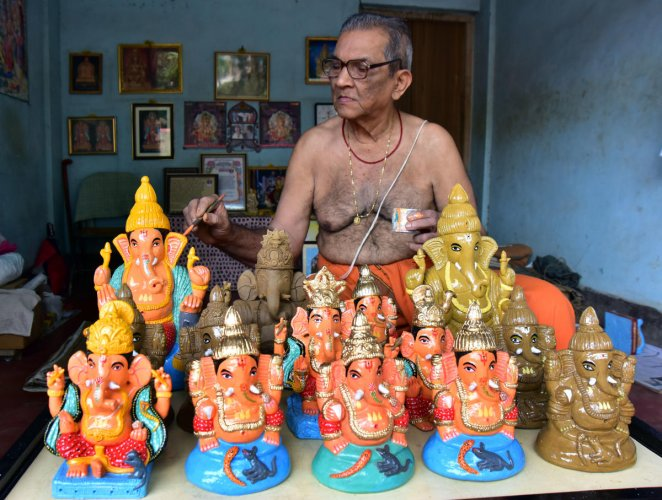 Damodar Shenoy, who is engaged in making Ganesha idols for the last 60 years, gives final touches to an idol of Lord Ganesha in Car Street in Mangaluru.
