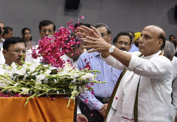 Defence Minister Rajnath Singh pays his last respects to the mortal remains of BJP leader and former finance minister Arun Jaitley at BJP HQ, in New Delhi on Sunday. PTI file photo