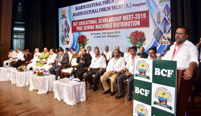 MLA U T Khader speaks at BCF educational scholarship meet-2019 and free sewing machines distribution programme held at Town Hall in Mangaluru on Sunday.