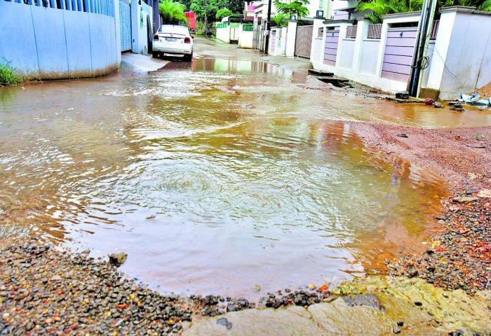 Sewage overflowing from the collapsed manhole on 1st Cross, Vas Lane, Mangaluru.