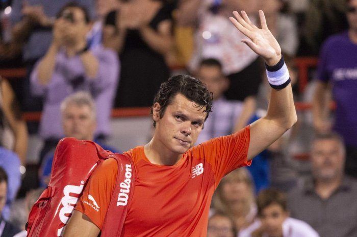 Milos Raonic waves to the crowd as he walks off the court after withdrawing from his match against countryman Felix Auger-Aliassime during the Rogers Cup men tournament. AP/PTI