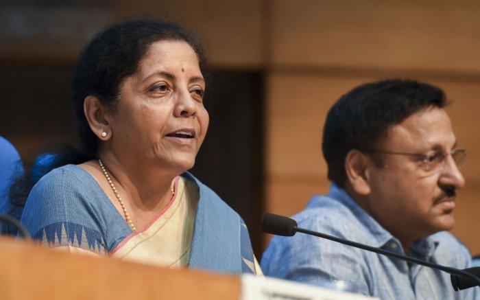 Finance Minister Nirmala Sitharaman with finance secretary Rajiv Kumar during a press conference in New Delhi, Friday, Aug 23, 2019. (PTI Photo)