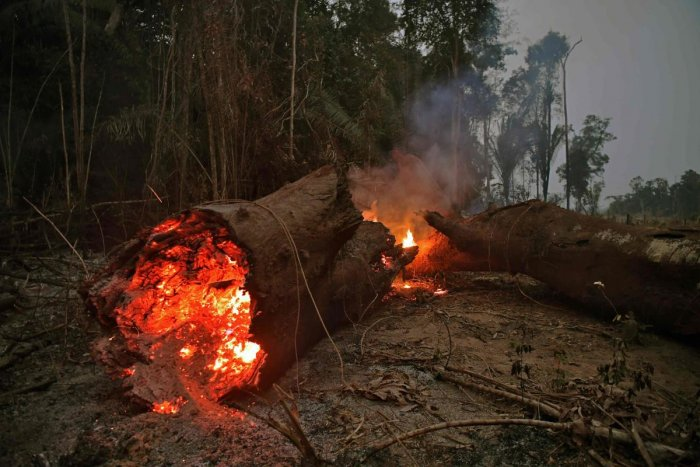 President Jair Bolsonaro authorized Friday the deployment of Brazil's armed forces to help combat fires raging in the Amazon rainforest. (Photo by AFP)