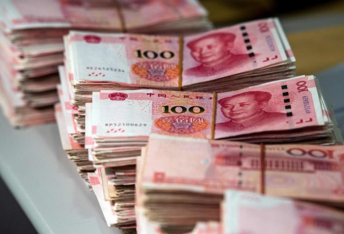 The onshore yuan fell to 7.1487 to the US dollar, its weakest point since early 2008, in Asian trading. AFP file photo