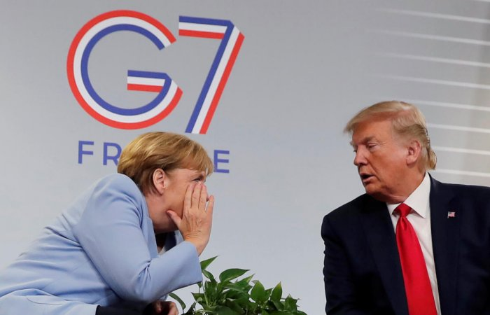 U.S. President Donald Trump meets German Chancellor Angela Merkel for bilateral talks during the G7 summit in Biarritz. (Reuters Photo)