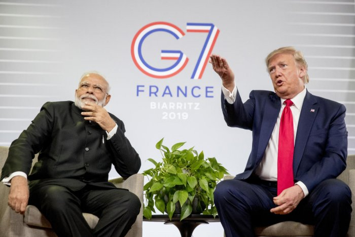 President Donald Trump, accompanied by Indian Prime Minister Narendra Modi, left, speaks during a bilateral meeting at the G-7 summit in Biarritz, France. (AP Photo)