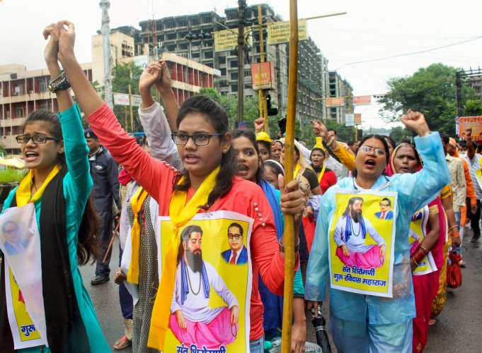 Members of Ahirwar Community take part in protest rally against the demolition of a Sant Ravidas temple in New Delhi. (PTI Photo)