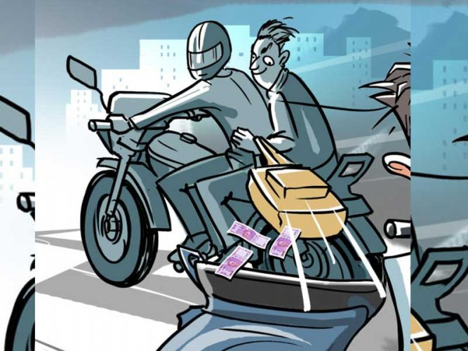Before Reddy could realise what was happening, the man quickly took the bag of money and rode away ona Hero Splendor, the police said. (DH Illustration. For representation purpose)