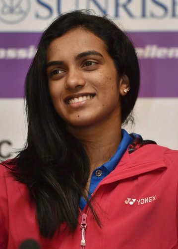 Olympic silver medallist Sindhu called on the sports minister following her arrival here. (PTI Photo)
