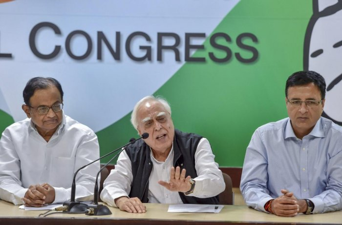 """Appearing for Chidambaram, senior advocate Kapil Sibal said the agency cannot place documents in the court randomly and """"behind the back"""" for seeking custody of the accused. (PTI Photo/Ravi Choudhary)"""