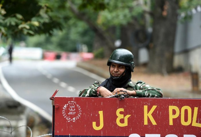 The security personnel deployed to maintain law and order stayed put even as restrictions were lifted from most areas of the valley, the officials said. (AFP Photo)