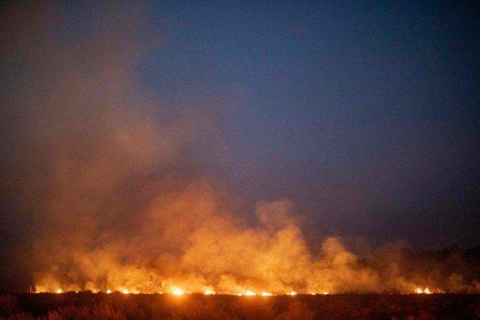 A fire burns out of control after spreading onto a farm along a highway in Nova Santa Helena municipality in northern Mato Grosso State, south in the Amazon basin in Brazil. (AFP Photo)