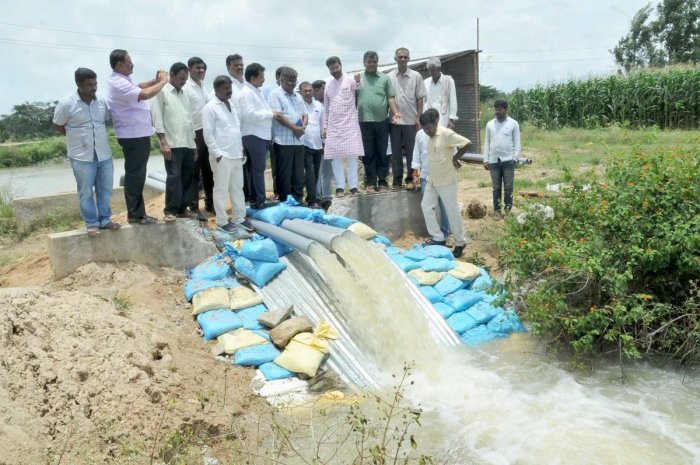Minister C T Ravi inspects the pump installed at Devikere to draw water to Karagada canal.