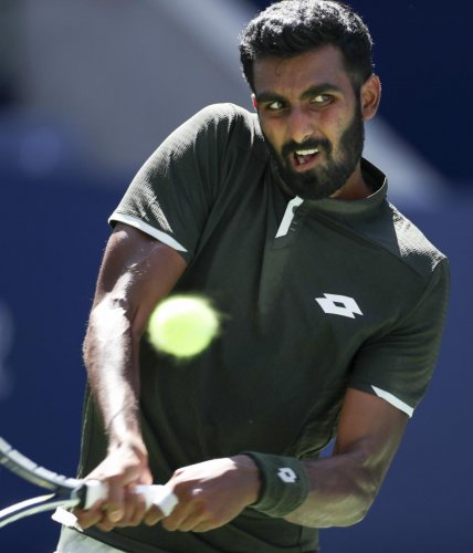 Prajnesh Gunneswaran, of India, against Daniil Medvedev, of Russia, during the first round of the US Open tennis tournament Monday, Aug. 26, 2019, in New York. AP/PTI