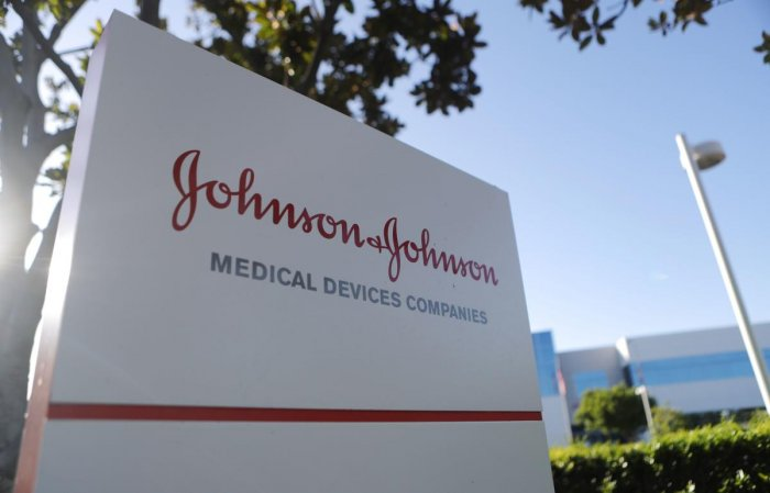 A sign posted at the Johnson & Johnson campus on August 26, 2019 in Irvine, California. A judge has ordered the company to pay $572 million in connection with the opioid crisis in Oklahoma. Mario Tama/Getty Images/AFP