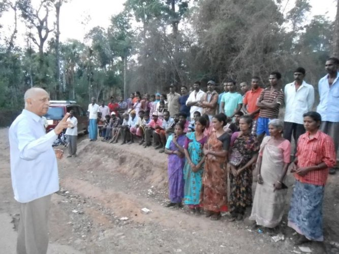 A K Subbaiah interacting with Diddalli victims in 2017.