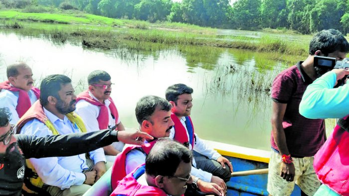 Belthangady MLA Harish Poonja, Tahsildar Ganapathi Shastri and others travel in a boat between Valalu in Puttur taluk and Mugeradka in Belthangady taluk.