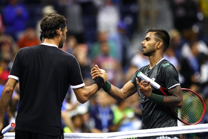 Roger Federer of Switzerland shakes hands with Sumit Nagal of India after their Men's Singles first round match on day one of the 2019 US Open. (Getty images/AFP)