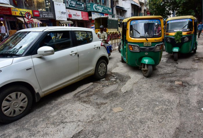 The BBMP has earmarked Rs 12 crore for filing up potholes on major roads. The picture shows a pothole-filled BVK Iyengar Road in Chickpet. DH PHOTO/IRSHAD MAHAMMADA