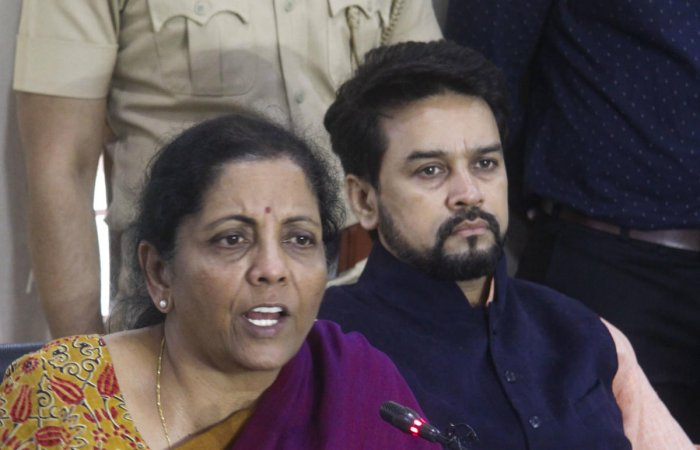 Finance Minister Nirmala Sitharaman along with Minister of State Anurag Thakur addresses a press conference in Pune (PTI Photo)